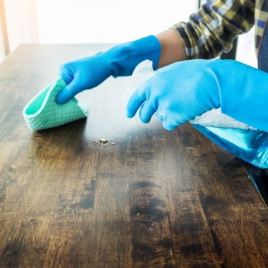 man cleaning table